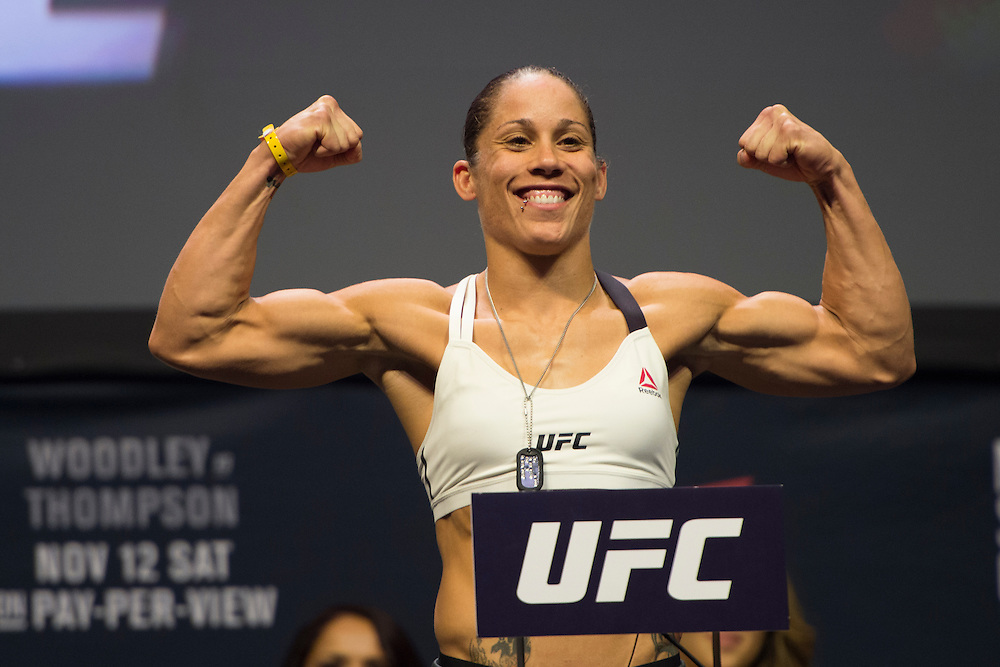 Liz Carmouche steps on the scale during the UFC 205 weigh-ins at Madison Square Garden in New York, New York on November 11, 2016.  (Cooper Neill for The Players Tribune)