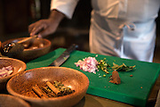 Sous Chef Sujith Arlyaratne uses cinnamon paste using a cinnamon stick and a dash of water at the Nugagama Restaurant at the Cinnamon Grand Hotel in central Colombo. The restaurant is renowned for its traditional 'village' Sri Lankan food with every dish using cinnamon in some degree.
