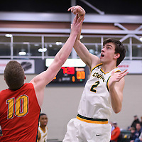 2nd year guard Samuel Hillis (2) of the Regina Cougars in action during the home game on January  27 at Centre for Kinesiology, Health and Sport. Credit: Arthur Ward/Arthur Images