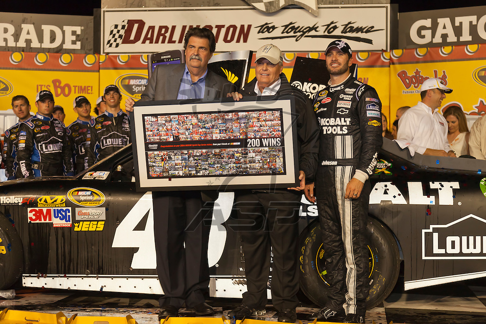 DARLINGTON, SC - MAY 12, 2012:  Jimmie Johnson (48) holds off Denny Hamlin and the rest of the field to win the Bojangles Southern 500 race at the Darlington Raceway in Darlington, SC.  This win is the 200th victory for Hendrick Motorsports