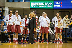 The Oklahoma Sonners bench looks on during a defensive play against the West Virginia Mountaineers during the second half at the WVU Coliseum.