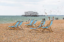 © Licensed to London News Pictures. 06/05/2019. Brighton, Deckchairs stand unused on the beach in Brighton and Hove as colder weather is hitting the seaside resort on the May Bank holiday weekend. Photo credit: Hugo Michiels/LNP