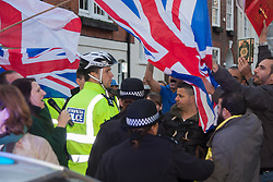 "Mayfair, London, November 28th 2014. A protest against Egypt's leader Al-Sisi descended into moinor scuffles as right wing ""patriots"" from anti-Islamic group Britain First arrived to protest against the presence of Islamist preacher Anjem Choudary, who was recently arrestred as part of an ant-terror operation. Playing patriotic British Music, Britain First accused Muslims of worshiping a ""devil"" and a ""paedophile prophet"". Police had to intervene before hotheads on both sides became violent. PICTURED: Police officers attempt to separate Britain First and Muslim protesters."