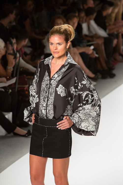 Black mini-skirt with white stiching, a black and white print top  and a black and white print vest. By Zang Toi, shown at his Spring 20132 Fashion Week show in New York.