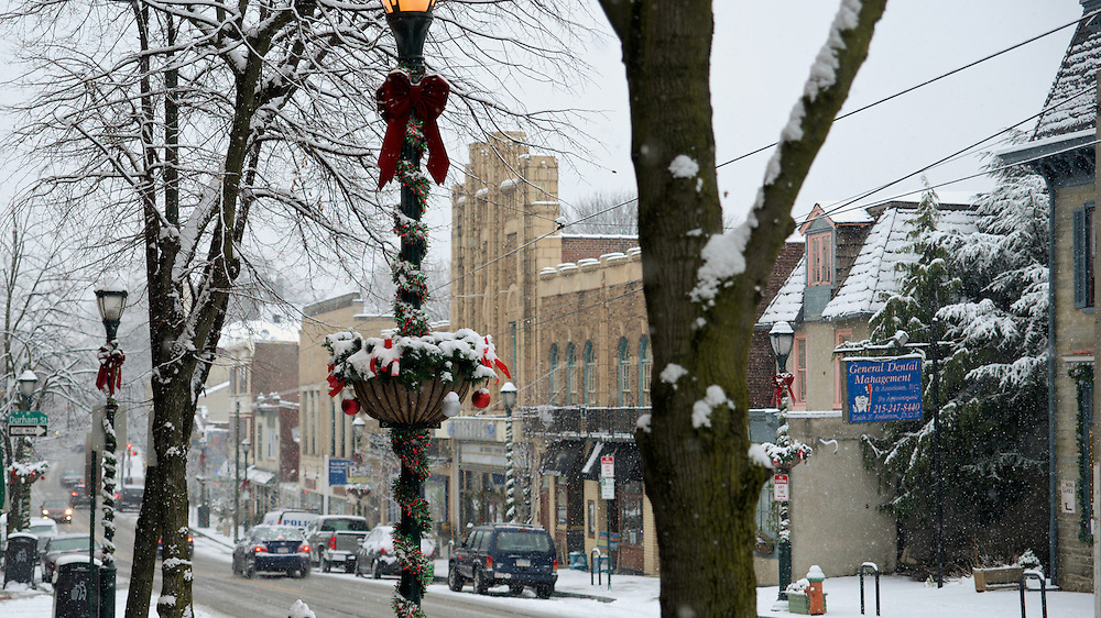 Holiday decorations on the street posts alongside germantown Avenue catch some of the snow that fell in the last days of the year. One or two inches of snow covered the area. ...