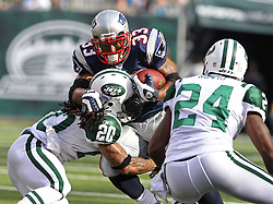Sept 19, 2011; East Rutherford, NJ, USA; New York Jets cornerback Kyle Wilson (20) hits New England Patriots running back Kevin Faulk (33) during the 1st half at the New Meadowlands Stadium.