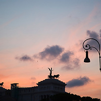 The monument of Victor Emmanuel silhoueted at sunset, Rome, Italy