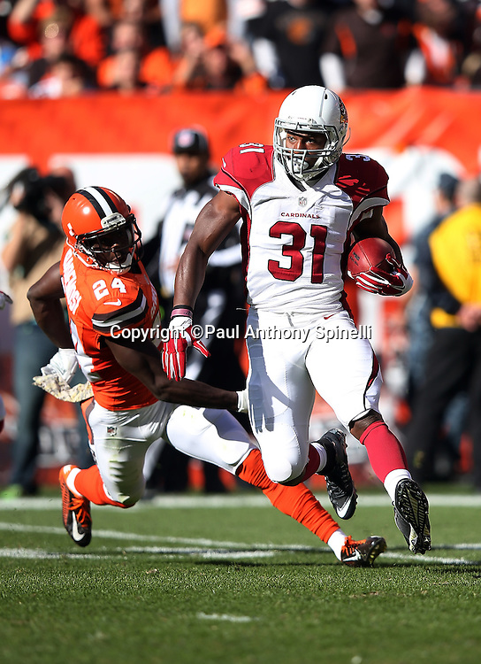Arizona Cardinals running back and kick returner David Johnson (31) is chased by Cleveland Browns cornerback Johnson Bademosi (24) as he returns a kick during the 2015 week 8 regular season NFL football game against the Cleveland Browns on Sunday, Nov. 1, 2015 in Cleveland. The Cardinals won the game 34-20. (©Paul Anthony Spinelli)