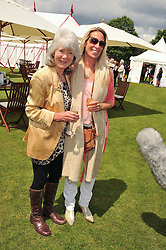 Left to right, JILLY COOPER and her daughter at the Cartier Queen's Cup Polo Final, Guards Polo Club, Windsor Great Park, Berkshire, on 17th June 2012.