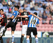 Tim Chow scores to make it 1-0 to Wigan Athletic during the Sky Bet Championship match between Wigan Athletic and Brighton and Hove Albion at the DW Stadium, Wigan, England on 18 April 2015.