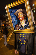 New York, NY, October 31, 2013. A man wearing a frame, his face made up to resemble a self-portrait by Vincent Van Gogh, in the Greenwich Village Halloween Parade.
