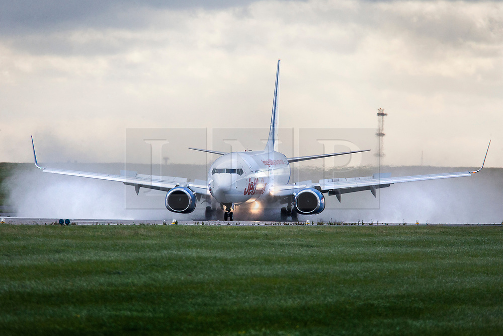 © Licensed to London News Pictures. 13/09/2017. Leeds UK. A Jet2 aircraft lands in heavy rain this morning from Storm Aileen at Englands highest airport, Leeds Bradford Airport. Photo credit: Andrew McCaren/LNP