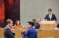 Nederland. Den Haag, 27 oktober 2010.<br /> De Tweede Kamer debatteert over de regeringsverklaring van het kabinet Rutte.<br /> D66 fractievoorzitter Alexander Pechtold en Groenlinks fractievoorzitter Femke Halsema luisteren naar premier Rutte. Oppositie.<br /> Kabinet Rutte, regeringsverklaring, tweede kamer, politiek, democratie. regeerakkoord, gedoogsteun, minderheidskabinet, eerste kabinet Rutte, Rutte1, Rutte I, debat, parlement<br /> Foto Martijn Beekman