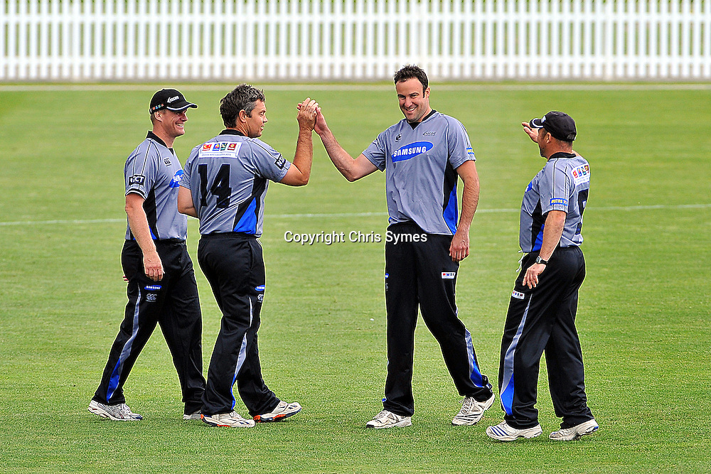 Llorne Howell(L) celebrates with Geoff Barnett after he took a wicket during NZCPA Masters v Nelson at Saxton Oval, Nelson, New Zealand. Sunday 20 November 2011. Photo: Chris Symes/www.photosport.co.nz