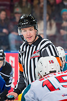 KELOWNA, CANADA - JANUARY 25: Referee Mike Campbell stands at center ice for the face off between the Kelowna Rockets and the Victoria Royals on January 25, 2019 at Prospera Place in Kelowna, British Columbia, Canada.  (Photo by Marissa Baecker/Shoot the Breeze)