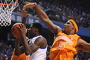 UK guard Archie Goodwin, left, has his shot contested by Tennessee forward Jarnell Stokes in the first half. The University of Kentucky Men's Basketball team hosted University of Tennessee , Tuesday, Jan. 15, 2013 at Rupp Arena in Lexington . Photo by Jonathan Palmer/Special to the Courier-Journal