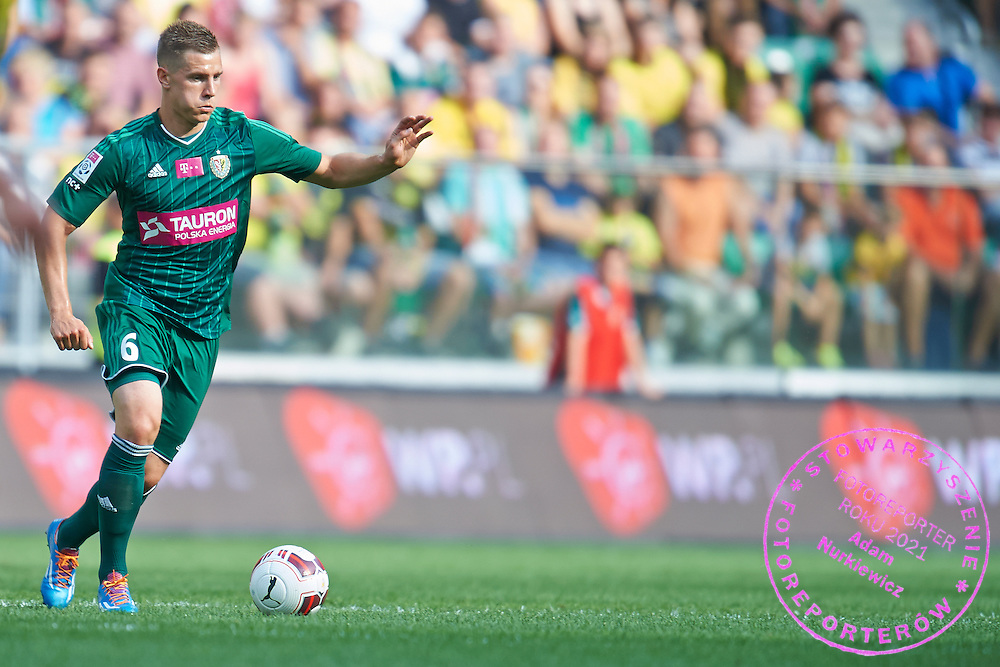 Tomasz Holota of Slask Wroclaw controls the ball during international friendly soccer match between WKS Slask Wroclaw and BVB Borussia Dortmund on Municipal Stadium in Wroclaw, Poland.<br /> <br /> Poland, Wroclaw, August 6, 2014<br /> <br /> Picture also available in RAW (NEF) or TIFF format on special request.<br /> <br /> For editorial use only. Any commercial or promotional use requires permission.<br /> <br /> Mandatory credit:<br /> Photo by &copy; Adam Nurkiewicz / Mediasport