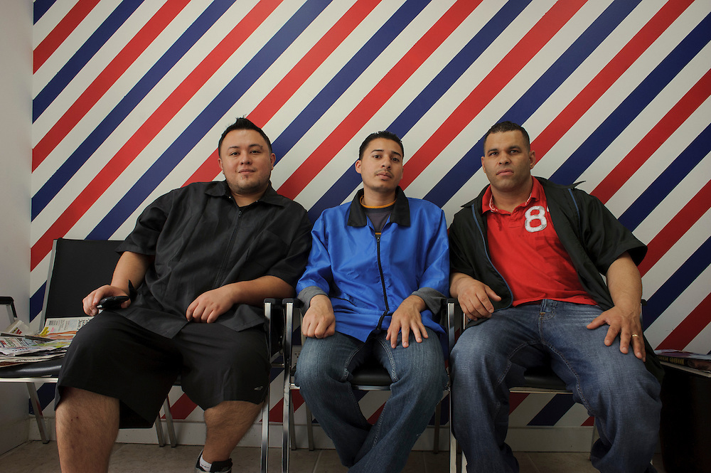(left to right) Christian Molina from Ecuador, Sergio Joya from El Salvador and Aquiles Baez from Dominican Republic pose for the camera at the Barber Shop where they work located in Brentwood. (July. 14, 2012)