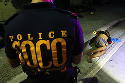 October 1, 2016 - Manila, Philippines - Members of S.O.C.O. (Scene of the Crime Operatives) process the crime scene and the remain of Un-identified allegedly drug dealers are the victims of summary executions at Plorentino St. corner Lacson Lacson St. in Brgy. 479, Sampaloc. (Credit Image: © Gregorio Dantes Jr/Pacific Press via ZUMA Wire)