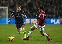 Football - 2018 / 2019 Premier League - West Ham United vs. Manchester City<br /> <br /> Felipe Anderson (West Ham United) sticks a leg out in an attempt to stop Kyle Walker (Manchester City) at the London Stadium<br /> <br /> COLORSPORT/DANIEL BEARHAM