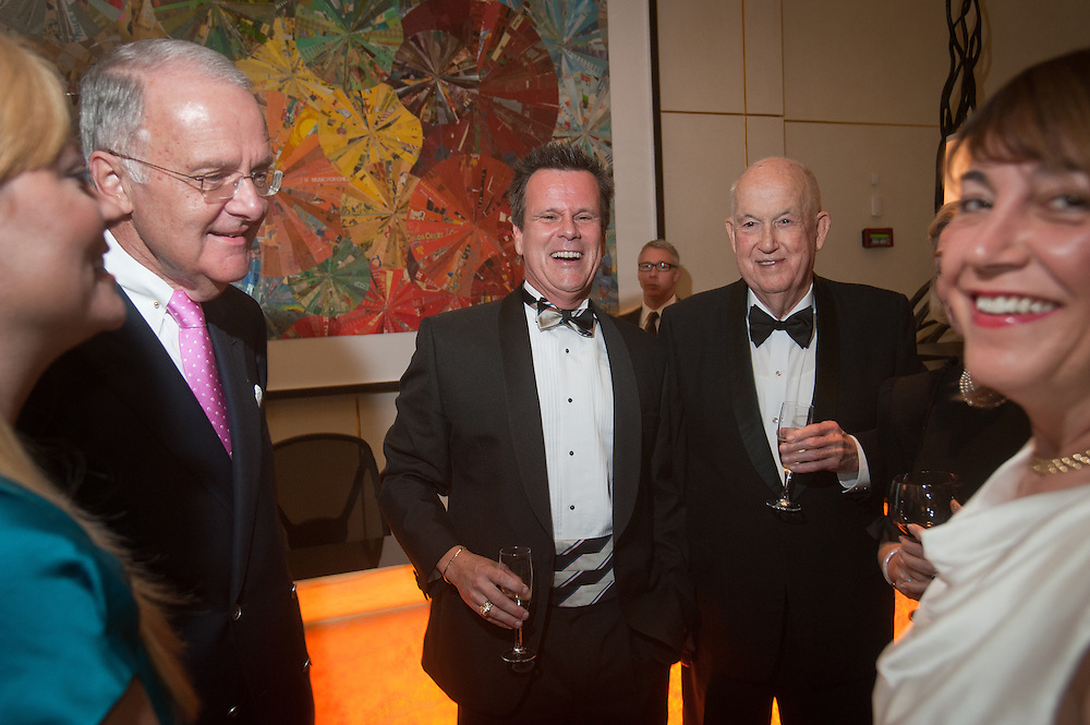 The Four Seasons Residences Austin hosted a party Friday night for current, future and prospective residents. Tom and Ray Langston (C) share a laugh with Jim Owen (L) and Kimberly Levinson.