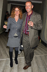 ARIEL ROGER-PARIS and his wife MARIA MARSHALL at a dinner hosted by Arnaud Bamber MD of Cartier, Amanda Sharp and Matthew Slotover Directors of the Frieze Art Fair to celebrate artists featured in the 2005 Frieze Art Fair Curatorial Programme at Nobu-Berkeley, 15th Berkeley Street, London on 21st October 2005.<br />