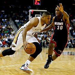 Oct 23, 2013; New Orleans, LA, USA; New Orleans Pelicans shooting guard Eric Gordon (10) drives past Miami Heat point guard Norris Cole (30) during the second half of a preseason game at New Orleans Arena. The Heat defeated the Pelicans 108-95. Mandatory Credit: Derick E. Hingle-USA TODAY Sports