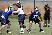 Los Angeles Rams rookie center Brian Allen (55), a 4th round pick in the 2018 NFL draft, and Los Angeles Rams center Jake Eldrenkamp (60) double team block Los Angeles Rams rookie defensive tackle Sebastian Joseph-Day (69), a 6th round pick in the 2018 NFL draft, during the Los Angeles Rams NFL football camp on Monday, June 4, 2018 in Thousand Oaks, Calif. (©Paul Anthony Spinelli)