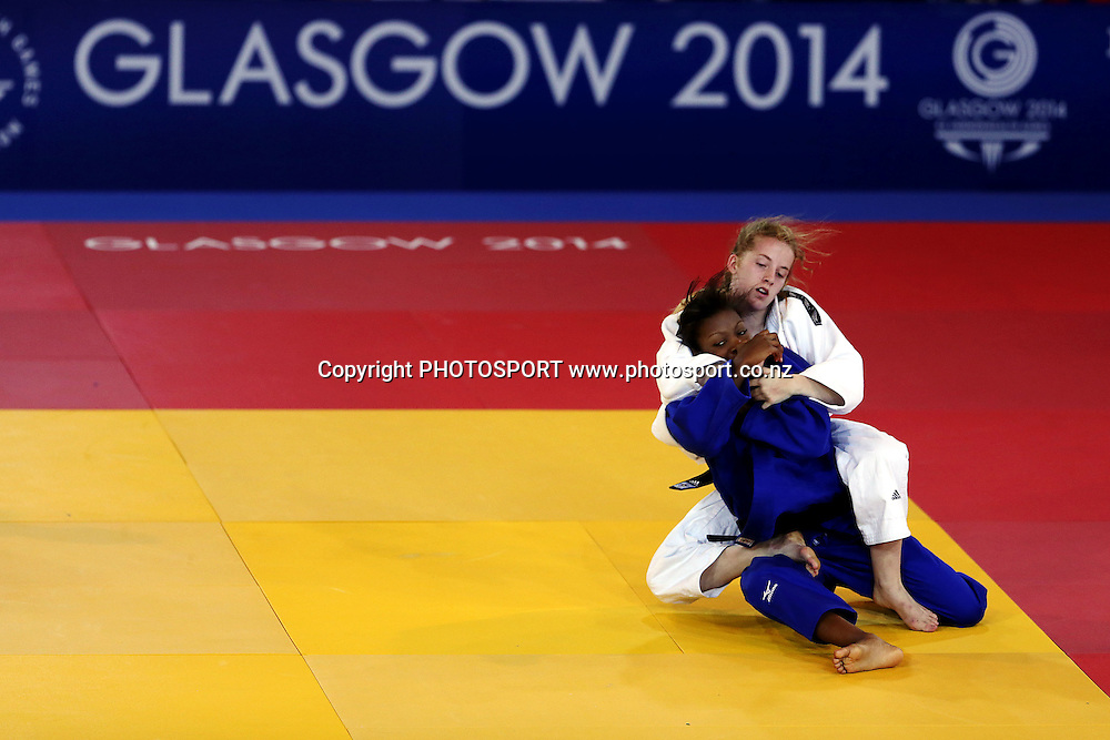 Chanel Kavanagh of New Zealand competes during the Womens -48kg Judo Quarter-finals against Onoh-Obasi Okey of Barbados on Day 1. Glasgow 2014 Commonwealth Games. Scottish Exhibition Conference Centre, Glasgow, Scotland. Thursday 24 July 2014. Photo: Anthony Au-Yeung / photosport.co.nz