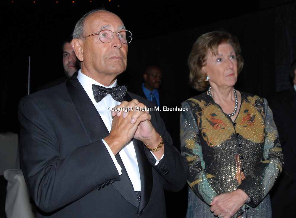Rich DeVos, left, owner of the NBA Orlando Magic basketball team, and wife, Helen DeVos, wait to speak during the annual Black Ties & Tennies charity gala in Orlando, Florida.