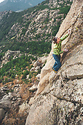 Dean Potter and Carlos Suarez climbing together without ropes in El Pajaro crag, La Pedriza, Spain
