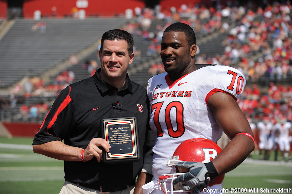 Apr 18, 2009; Piscataway, NJ, USA; Rutgers Athletic Director Tim Pernetti presents OL Desmond Wynn with the Mark Mills award for the most improved offensive player of spring practice during halftime of Rutgers' Scarlet and White spring football scrimmage.