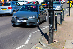 It appears one of the two cars involved clipped a streetlight as workers clear up the debris following a high speed crash involving two high performance cars on Chiselhurst High Street in South East London. London, August 22 2019.