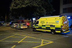 "© Licensed to London News Pictures. 21/07/2020. London, UK. A London Ambulance Service Incident Response Unit parked on High Street alongside police vehicles in Southall. A large scale emergency services operation underway while police are in a standoff with a person ""at height"" close to the Southall Fire station. Photo credit: Peter Manning/LNP"