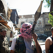 August 14, 2012 - Aleppo, Syria: A Free Syria Army (FSA) fighter prepares to head to the frontline in Aleppo's old city. The Syrian Army have in the past ten days increased their attacks on residential neighborhoods where Free Syria Army rebel fights have their positions in Syria's commercial capital, Aleppo. (Paulo Nunes dos Santos/Polaris)