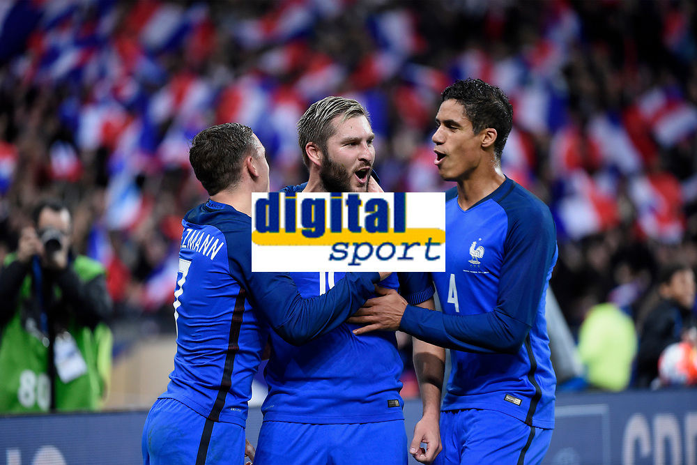 Andre Pierre Gignac celebrates scoring the second goal for his team with teammates during the International Friendly Game 2016 football match between France and Russia on March 29, 2016 at Stade de France in Saint Denis, France - Photo Jean Marie Hervio / Regamedia / DPPI