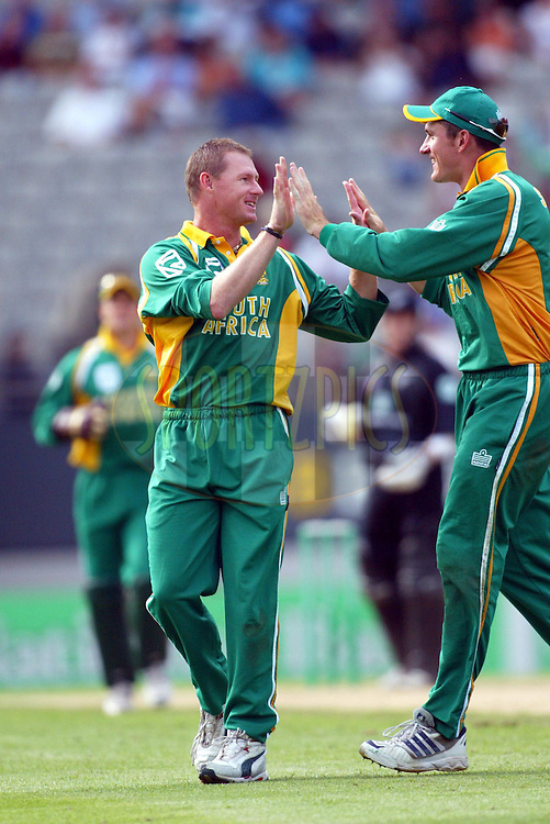 13 February 2004, International one day cricket, Eden Park, Auckland, New Zealand. Match 1 in series of 6, New Zealand vs South Africa..lance Klusener and Graeme Smith..Pic: Andrew Cornaga/Photosport