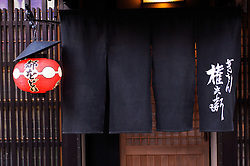 Detail of entrance to traditional restaurant in historic Gion District of Kyoto in Japan