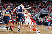 LOUISVILLE, KY - JANUARY 28: Peyton Siva #3 of the Louisville Cardinals dribbles around Steven Adams #13 of the Pittsburgh Panthers during the game at KFC Yum! Center on January 28, 2013 in Louisville, Kentucky. Louisville defeated Pitt 64-61. (Photo by Joe Robbins)