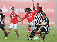 Benfica's player Renato Sanches (L ) fights for the ball with Nacional´s player João Aurélio   (R ) during Portuguese First League football match Nacional vs Benfica  held at Madeira Stadium, Funchal, 11 January 2016.  LUSA / GREGORIO CUNHA