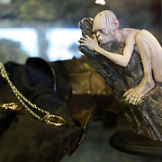A collectable of Lord of the Rings character Gollum at Weta Cave in  Miramar, Wellington. The Weta Cave screens a first-ever behind the scenes look at Weta and interviews with Weta co-founders Peter Jackson, Richard Taylor, Tania Rodger and Jamie Selkirk. The mini-museum, includes some of the characters, props and displays from  movies and a wide range of Weta related movie and TV merchandise..A life like figure of Lord of the Rings character Gollum, limited edition sculptures, hand-crafted by the artists at Weta, collectibles,. unique Weta designed clothing, jewellery and mementoes.. Weta Cave. Wellington, New Zealand, 25th January 2011.  Photo Tim Clayton.