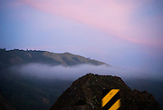 Dusk and sunset along the coastline cliffs of Highway 1 south through Big Sur, California