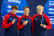 Thomas Hamer of Great Britain (left-Silver), Reece Dunn of Great Britain (centre-Gold), and Jordan Catchpole of Great Britain (right-Bronze) with their medals after the Men's 200 m Freestyle S14 during the World Para Swimming Championships 2019 Day 1 held at London Aquatics Centre, London, United Kingdom on 9 September 2019.