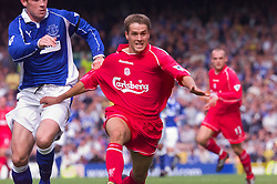 LIVERPOOL, ENGLAND - Saturday, September 15, 2001: Liverpool's Michael Owen and Everton's David Weir during the Premiership match at Goodison Park. (Pic by David Rawcliffe/Propaganda)