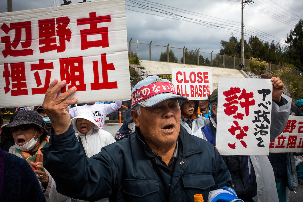 OKINAWA, JAPAN - FEBRUARY 9 :  Anti U.S. Base protesters shout with their placards while blocking construction cars and US marines from getting inside of the U.S Marine Base in Camp Schwab gate, protesting against the construction of the new U.S Marine base in Henoko, Nago, Okinawa prefecture, Japan on Feb. 9, 2017. Japan's government started offshore construction work Monday on relocating U.S. Marine Corps Air Station Futenma in Okinawa. (Photo by Richard Atrero de Guzman/NURPhoto)