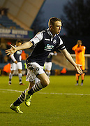 Millwall FC Midfielder Shane Ferguson celebrates his second goal during the Sky Bet League 1 match between Millwall and Colchester United at The Den, London, England on 21 November 2015. Photo by Andy Walter.