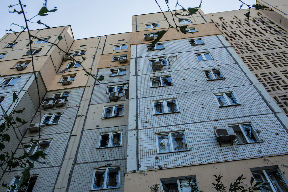 An apartment building damaged by shrapnel from a suspected grad rocket strike on Tuesday, July 29, 2014 in Donetsk, Ukraine.