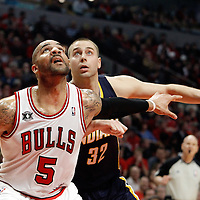 16 April 2011: Chicago Bulls power forward Carlos Boozer (5) vies for the rebound with Indiana Pacers small forward Josh McRoberts (32) during the Chicago Bulls 104-99 victory over the Indiana Pacers, during the game 1 of the Eastern Conference first round at the United Center, Chicago, Illinois, USA.