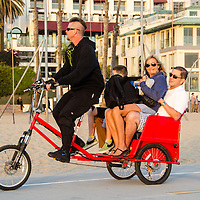Awesome Pedicab rolls along the Santa Monica Bike Path with four customers in tow on Thursday, October 10, 2013.
