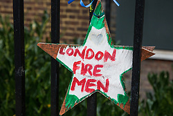 London, UK. 29 October, 2019. A tribute to the firefighters who attended the Grenfell Tower fire close to the site. A much-delayed public inquiry report into the Grenfell Tower disaster which killed 72 people to be published tomorrow has been criticised today for its emphasis on criticism of London Fire Brigade.
